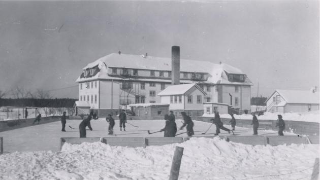 Boys playing hockey at the McIntosh, Ontario school
