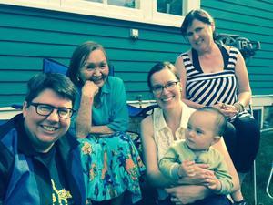 Mini, with editors Julie Rak, Keavy Martin and Norma Dunning, with Keavy Martin's son, Edzazii. Photo by Richard Van Camp.